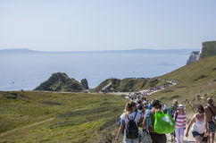 Free Durdle Door - People And The Blue Seas. Royalty Free Stock Photography - 99077977