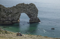 Durdle Door - people kissing on the grass. The picture some people kissing on the grass in Durdle Door, Dorset Stock Images