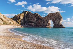 Durdle Door rock formations on coast in Dorset, England Royalty Free Stock Photography