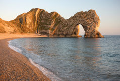 Durdle Door Sea Arch, Dorset. Durdle Door limestone sea arch at sunset, Dorset, England. Part of 'The Jurassic Coast', a UNESCO world heritage site Stock Images