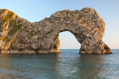Durdle Door Sea Arch Dorset. Durdle Door sea arch lit by the setting sun, Dorset, Part of 'The Jurassic Coast' UNESCO World Heitage Site Stock Image