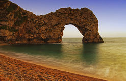 Durdle Door sea arch during the sunset Royalty Free Stock Photos