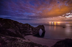 Durdle Door after sunset Stock Images