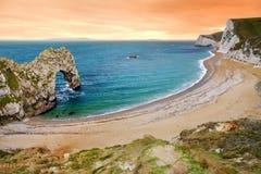 Durdle Door, natural limestone arch on the Jurassic Coast near Lulworth in Dorset, England. stock photos