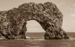 Durdle-Tür, Jura- Küste West- Lulworth, Dorset, Süd-England, Sepia lizenzfreies stockfoto