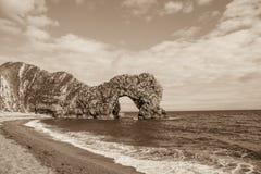 Durdle-Tür, Jura- Küste West- Lulworth, Dorset, Süd-England, Sepia stockfotografie