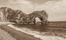 Durdle-Tür, Jura- Küste West- Lulworth, Dorset, Süd-England, Sepia lizenzfreie stockbilder