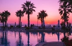 Free Duress, Albania. May 2018: People Photographing Scenic Sunset In Local Resort With Pool And Palm Trees. Royalty Free Stock Images - 117263939