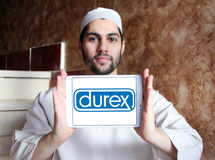 Durex condoms company logo. Logo of the world`s No.1 brand for condoms, durex on samsung tablet holded by arab muslim man Royalty Free Stock Image
