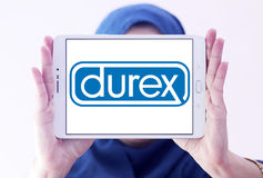 Durex condoms company logo. Logo of the world`s No.1 brand for condoms, durex on samsung tablet holded by arab muslim woman royalty free stock photos