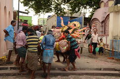 Durga Immersion. People carrying goddess Durga for immersion into the Ganges river of WestBengal, India Stock Photo