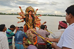 Durga Immersion. People gathered near the Ganges river at the time of immersion of goddess Durga in Bengal, India Royalty Free Stock Photo