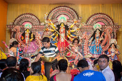 Durga pooja dussera celebration, India. Durga pooja or dussera celebration in Kolkata, India, a crowd gathered in front of the idol of Hindu goddess durga Royalty Free Stock Photos