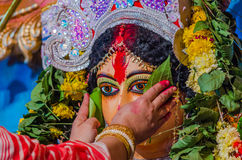 Durga Pooja. Traditional Indian Lady worshiping hindu goddess Durga during durga pooja and sindoor khela Stock Image