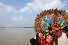 Durga puja festival. Devotees immerse huge decorated Durga idol in Hubli river during Durga Puja festival in Kolkata, India royalty free stock photos