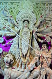 Durga Puja. Idol of Durga Maa made with sea shells in a Pandal shown on 11 Oct 2013 in Bandel, Kolkata, India. Durga puja is the biggest festival for Bengalis stock photography