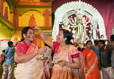 Durga Puja Sindur Khela (Vermilion ceremony). CALCUTTA - OCTOBER 6: Married Bengali Hindu women smear and play with vermilion during Sindur Khela traditional Stock Photos