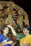 DURGA-VERMILION blessings OF PROSPERITY. On the occasion of immersion day of Durga puja, two married women give blessing each other for their long married life Royalty Free Stock Photos