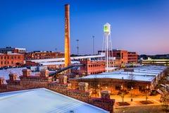 Durham norr Carolina Downtown på skymning Arkivfoton