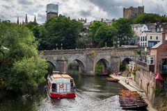 Durham, United Kingdom - July 30, 2018: View of Elvet Bridge over river Wear in the historic town Durham. Towers of Durham. Cathedral in background stock photo