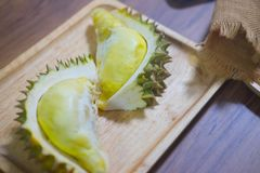 Durian fruit piece on a wooden plate. Durian king of fruit Stock Image