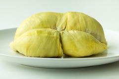 Durian på den vita maträtten Arkivfoton