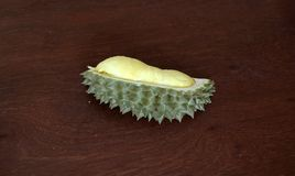 Durian peeled on the wooden table, one piece. Durian is an oval spiny tropical fruit. Durian peeled on the wooden table, one piece. Durian is an oval spiny Stock Images