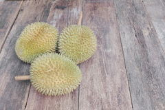 Durian ripe fruit  which has thorn on the wood  background Stock Photos