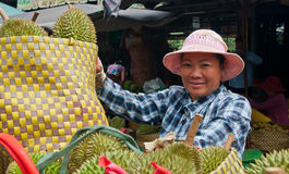 The Durian Seller. An Asian woman sells fresh durian fruit in the market in Vietnam Stock Photos