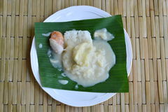 Durian sticky rice dressing coconut cream on banana leaf Royalty Free Stock Image