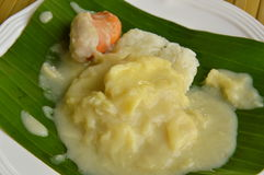 Durian with sticky rice dressing coconut cream on banana leaf Royalty Free Stock Photography
