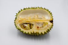 Durian tropical fruit on white background. King of fruits. Durian half cut with seed. Exotic fruit studio photo. royalty free stock images
