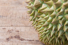 Durian on the wooden floor Royalty Free Stock Photos