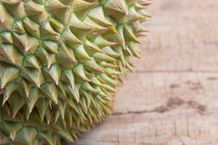 Durian on the wooden floor Royalty Free Stock Photo