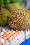 Durianfrukt och ägg royaltyfria foton