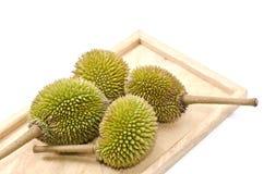 4 durians na madeira marrom Imagem de Stock Royalty Free