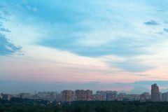 Durk blue and pink dusk sky over city Royalty Free Stock Photos