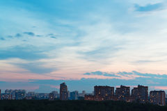 Durk blue and pink night sky over city Stock Images