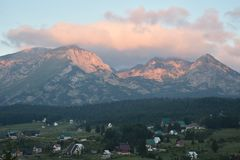 The Durmitor`s peaks in the early morning and the colorful clouds above it stock photos