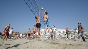 Group young Friends Playing Volleyball On Beach stock photos
