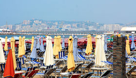 Durres. Albania. Durres. Multicolored beach umbrellas on a sandy beach Adriatic coast in a summer day. Durres is a popular resort in Albania Royalty Free Stock Image