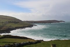Dursey Sound County Cork Ireland. With the wave crashing against the rocks royalty free stock image
