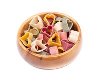 Durum wheat semolina heart-shaped 5 flavors pasta with vegetables in wooden bowl. Valentine`s Day stock images