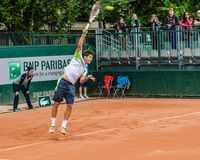 Dusan Lajovic plays second round in Roland Garros 2014. PARIS - MAY 29: Dusan Lajovic of Serbia serves during the 2nd round match at French Open, Roland Garros Royalty Free Stock Photos