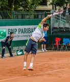 Dusan Lajovic plays second round in Roland Garros 2014. PARIS - MAY 29: Dusan Lajovic of Serbia servs during the 2nd round match at French Open, Roland Garros on Stock Photos