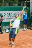 Dusan Lajovic plays second round in Roland Garros 2014. PARIS - MAY 29: Dusan Lajovic of Serbia servs during the 2nd round match at French Open, Roland Garros on Royalty Free Stock Images