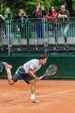Dusan Lajovic plays second round in Roland Garros 2014. PARIS - MAY 29: Dusan Lajovic of Serbia servs during the 2nd round match at French Open, Roland Garros on Stock Photo