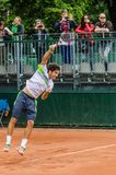 Dusan Lajovic plays second round in Roland Garros 2014. PARIS - MAY 29: Dusan Lajovic of Serbia servs during the 2nd round match at French Open, Roland Garros on Royalty Free Stock Image