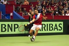 Dusan Lajovic return a ball-1 Stock Photo