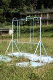 Dusche eines verlassenen Gemeinschaftspools Lizenzfreies Stockfoto